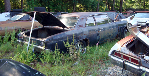 Antique Chevy auto parts yard, vintage Chevy car parts junkyard, old Chevrolet car salvage yard, classic Chevy junk yard car parts, antique Chevy auto replacement parts
